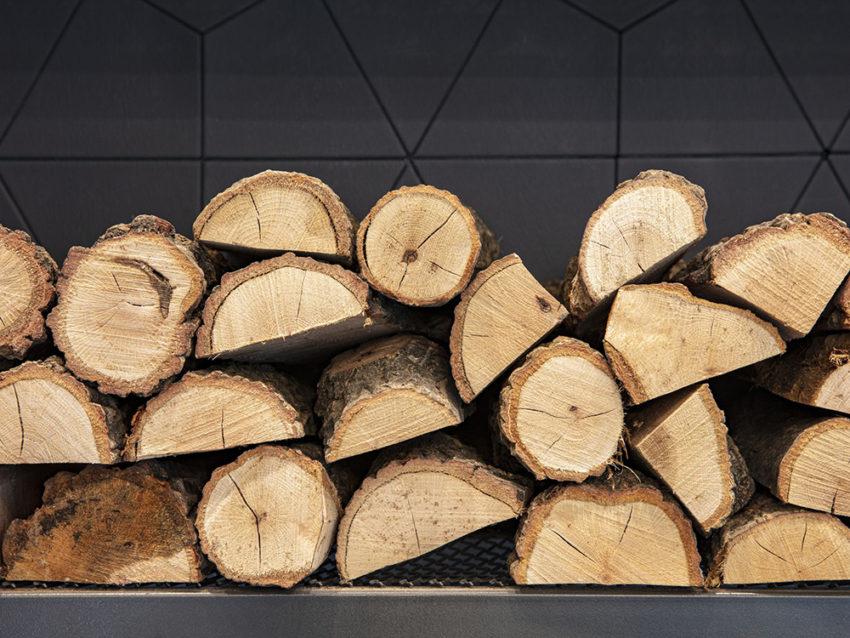 firewood near fireplace 1152769365 70d543d281034845ac80ca2bea4056af