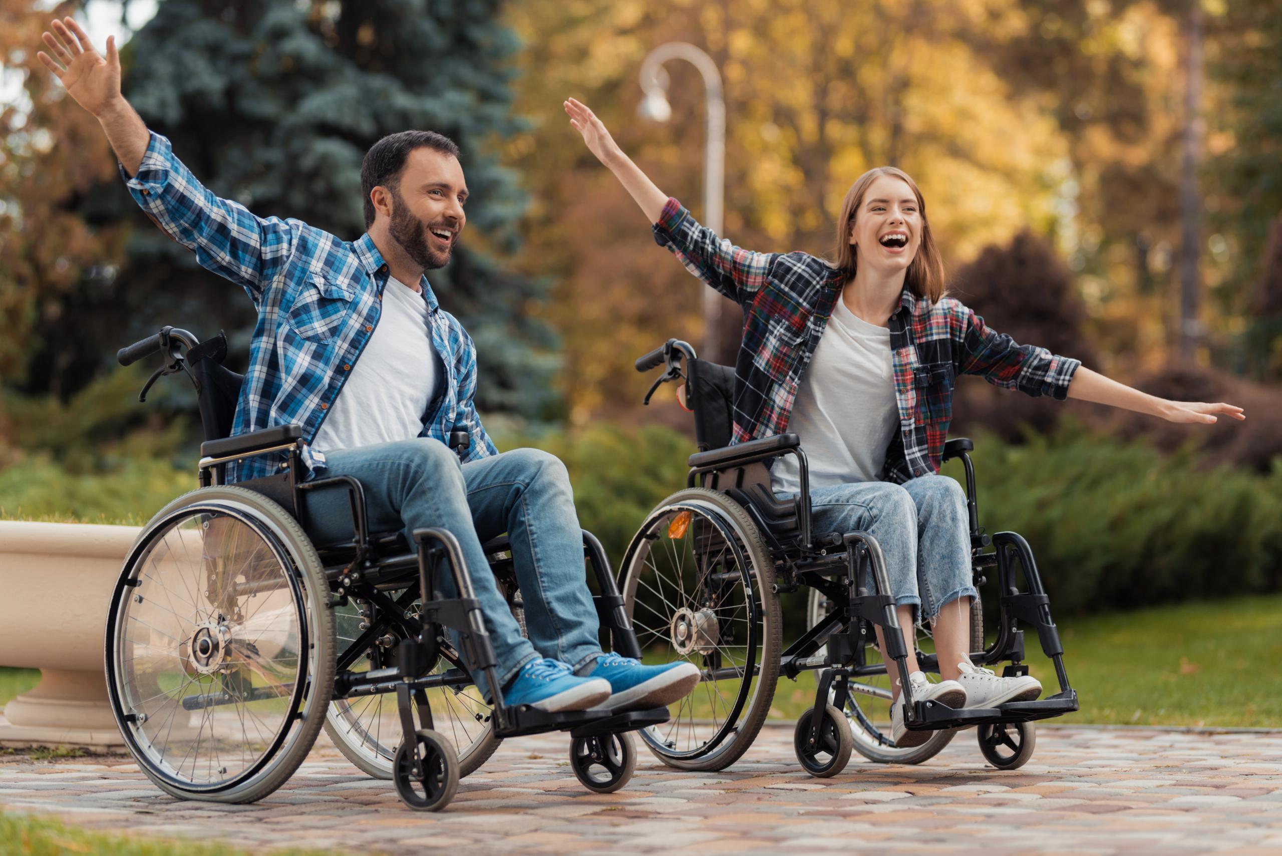 man woman wheelchairs ride around park scaled